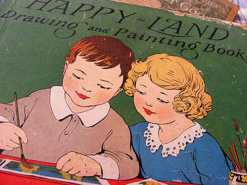 Photograph of Happy-Land book cover showing two children painting together