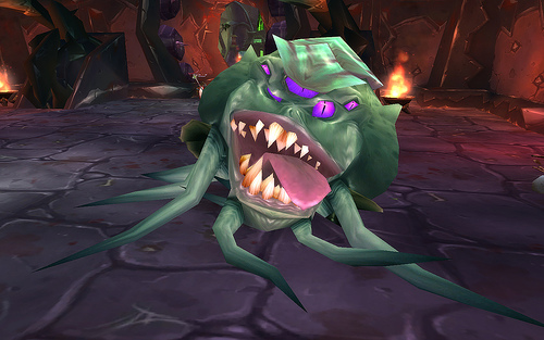 Screenshot of Broggok, the many-eyed, green boss in Blood Furnace