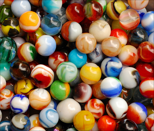 Photo of many coloured marbles
